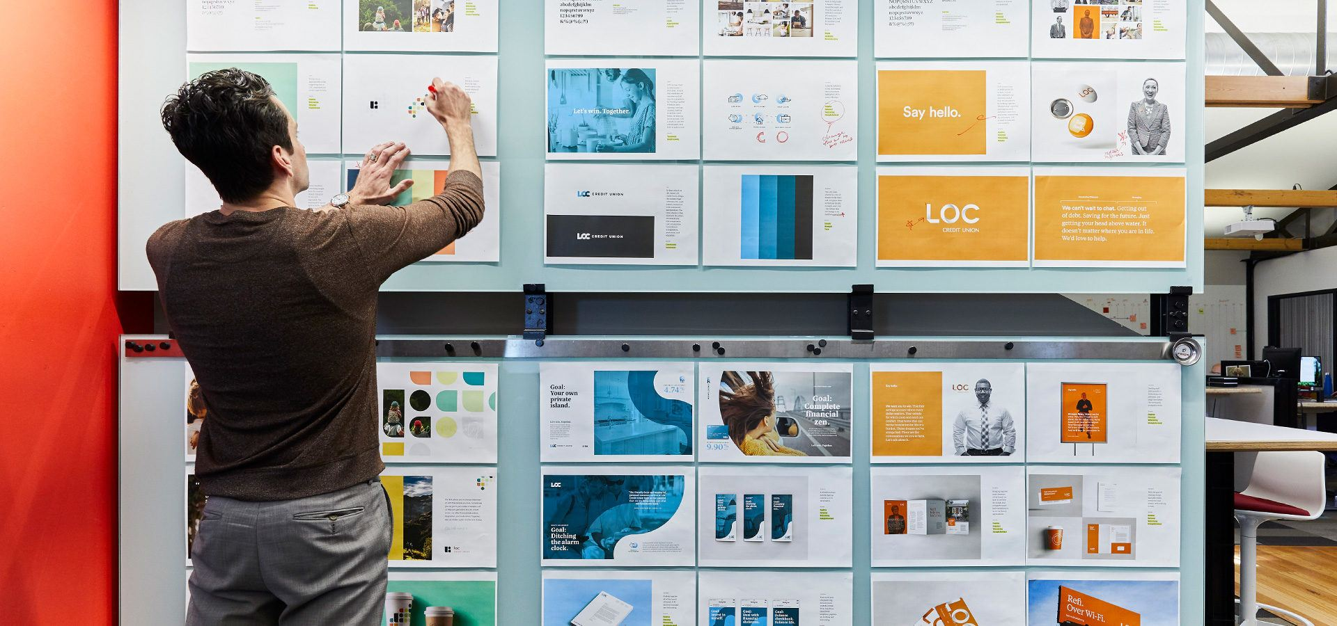 Creative director marking up creative for brand updates and graphic design.