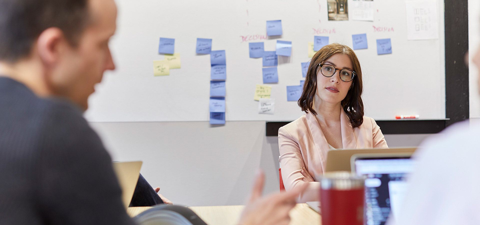 Employees working together on a brand-strategy initiative.